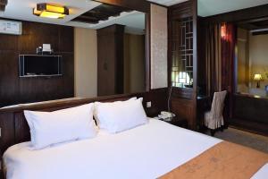 Baolong Homelike Hotel (Youyi Branch)