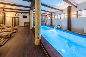 ZimaSnow Ski & Spa Club - Accommodation - Bukovel