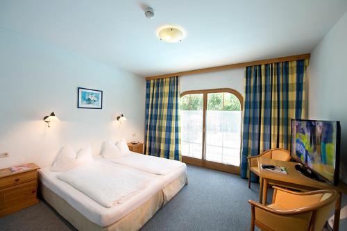 Фото отеля Ferienhotel Alpenhof