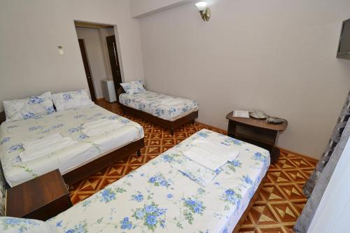 Cameră cvadruplă (Quadruple Room)