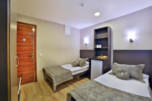 Sanli Suite Hotel foto della camera