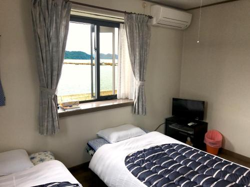 Standard Room with Tatami Area and Shared Bathroom - Ocean View