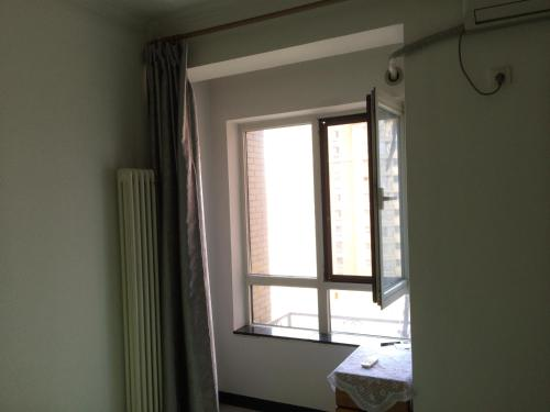 Beijing Sunshine Apartment photo 6