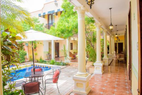 Hotel casa de las columnas en m rida desde 646 trabber for Hoteles en merida con piscina