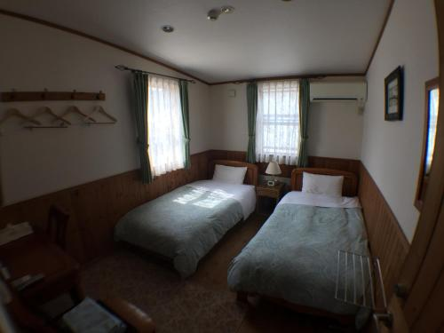 Twin Room with Shared Bathroom - Non-Smoking