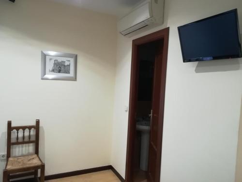 Hostal Palacios istabas fotogrāfijas