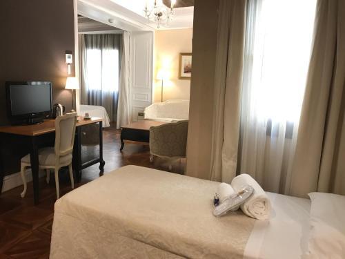Deluxe Premium Zimmer mit Zustellbett Hotel Casa 1800 Sevilla 26