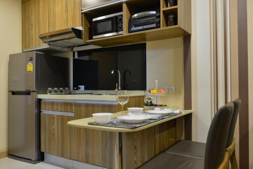 Ten Ekamai Suites by Aspira photo 34