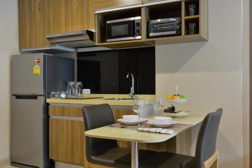Ten Ekamai Suites by Aspira photo 65