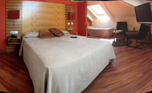 Dreibettzimmer Hotel Spa QH Centro León 1