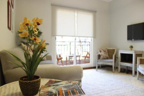 . Flora Apartments