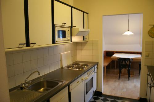 Фото отеля Romantik Residenz (Ferienwohnungen Hotel Im Weissen Rossl) - Dependanc