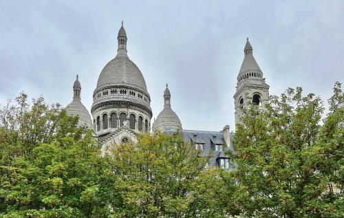 In artist village of Montmartre with view on Sacre Coeur photo 27