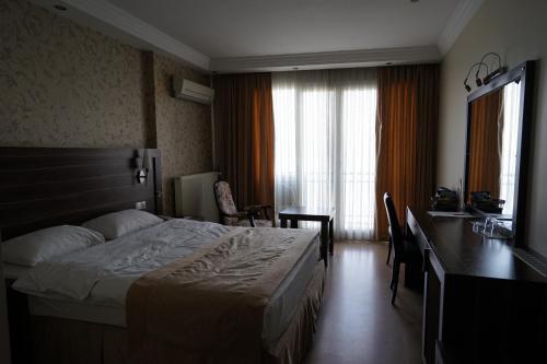 Yalihan Ari Hotel foto della camera