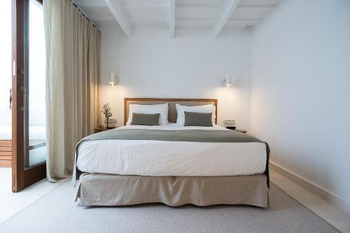 Suite Deluxe con terraza - Uso individual S'Hotelet d'es Born - Suites & SPA 23