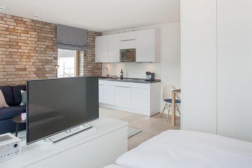 . 2,5 Zi Design Loft Wohnung mit Gartensitzplatz