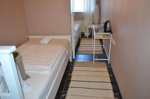 Хостел Казанское Подворье Двухместный номер с 2 отдельными кроватями и общей ванной комнатой