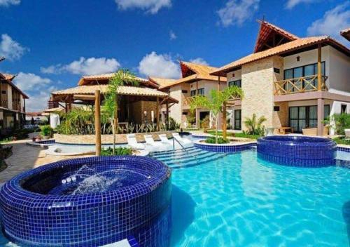 Bangalô com área de lazer estilo resort