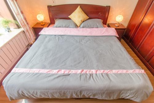 Joy City Deluxe Two-bedroom Apartment photo 7