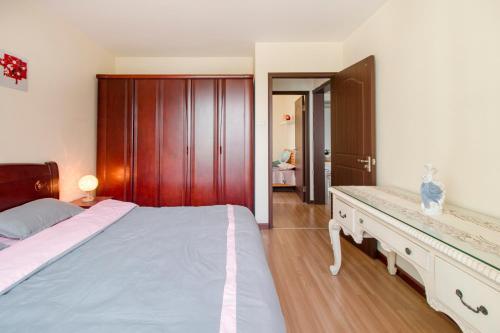 Joy City Deluxe Two-bedroom Apartment photo 8