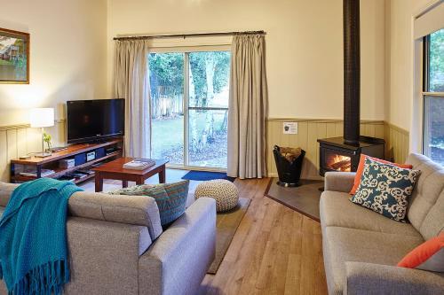 Фото отеля Alpine Valley Cottages