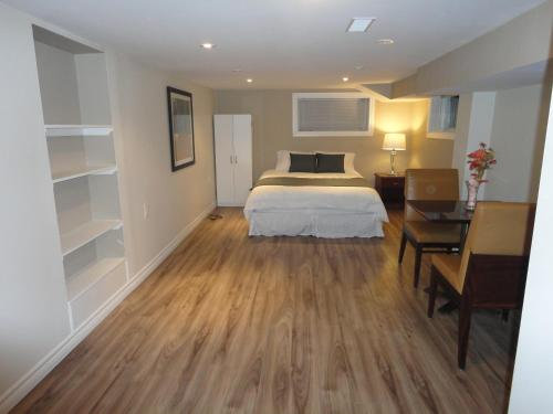 Large Room with Shared Bathroom - Basement Level
