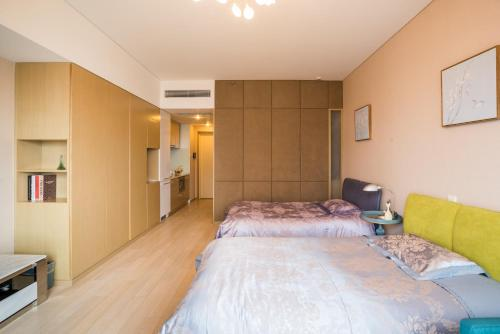 Qingdao Lejiaxuan Yuexi Apartment Hongkong Central Rd The MIXC Branch фотографии номера