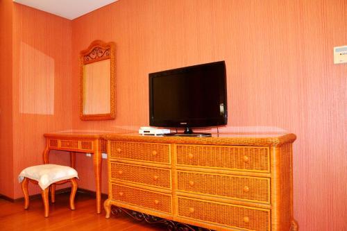 Фото отеля Tianjin Jinta City Impression Apartment