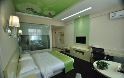 . JUNYI Hotel Yunnan Mang City Meili Spring