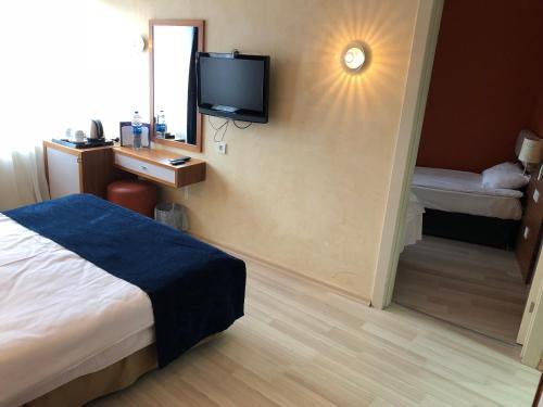 صور غرفة Ambassador Hotel
