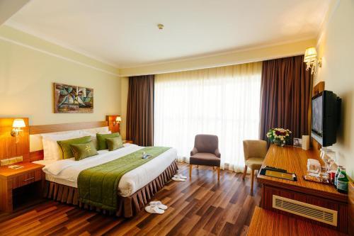Golden Tulip Hotel & Casino istabas fotogrāfijas