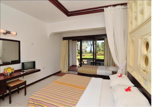 Reef Hotel Mombasa foto della camera