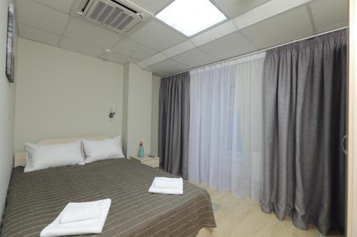 Город Отель Двухместный номер Делюкс с 1 кроватью