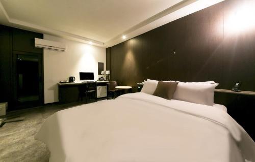 Foto kamar Hotel Wall