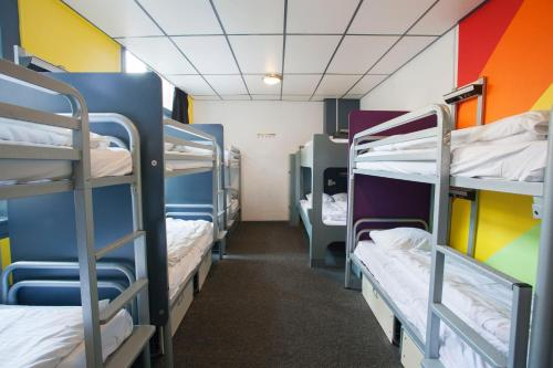 Queen Bed in 12 Person Mixed Dormitory Room