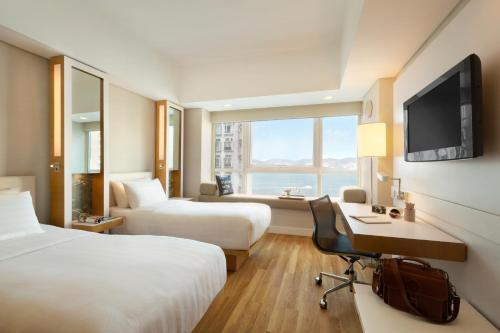 Hotel Jen Hong Kong Двухместный номер Делюкс с 2 отдельными кроватями и видом на гавань