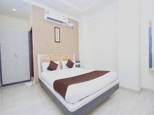 Фото отеля OYO 8446 Bouvana Residency