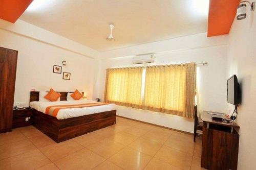 Фото отеля 10 Blossoms Serviced Apartments Navrangpura