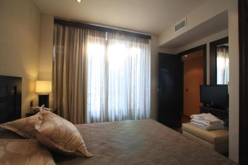 Suite Apartamento de 2 dormitorios con acceso gratuito al spa Casa Baños de la Villa 15