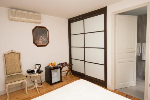 Habitación Individual interior Hostal Central Palace Madrid 15