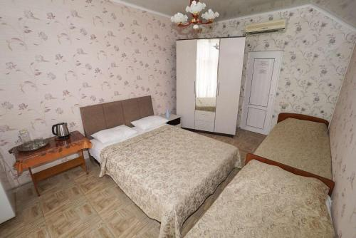 Cameră cvadruplă cu duş (Quadruple Room with Shower)
