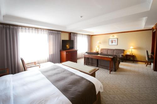 Commodore Hotel Gyeongju стая снимки