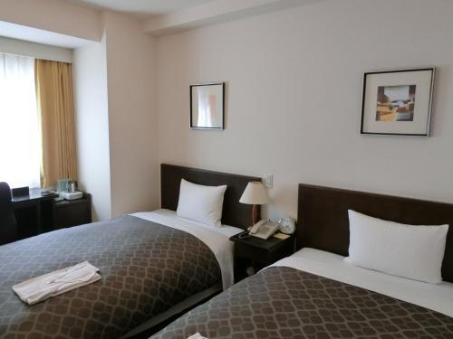 拉西奧經濟型酒店 Laxio Inn