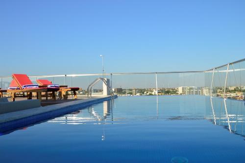 Фото отеля Palmeiras Suite Hotel