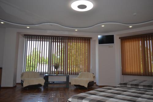 Cameră cvadruplă de lux (Luxury Quadruple Room)