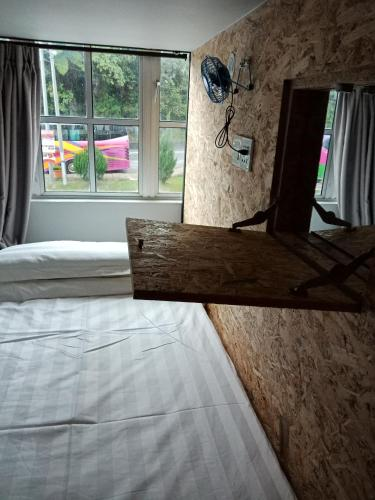 Single Bed with Window View in Mixed Dormitory Room