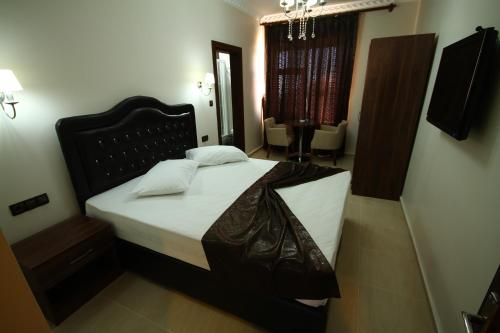 Gazi Konagi Butik Hotel istabas fotogrāfijas