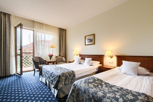 Hotel Ossa Congress & Spa Pokój Dwuosobowy typu Deluxe z 1 lub 2 łóżkami i balkonem