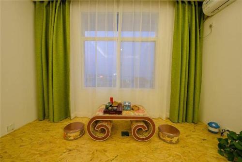 صور غرفة She Meng Ling Qi Yuan Hotel