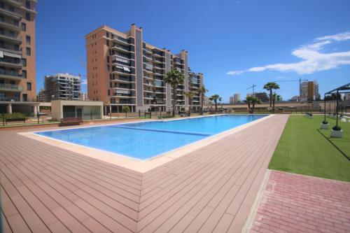 . CasaTuris Playa, piscina y parking en Residencial San Juan SJ102